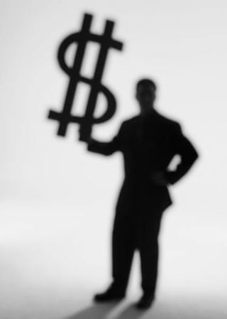 Man holding dollar sign
