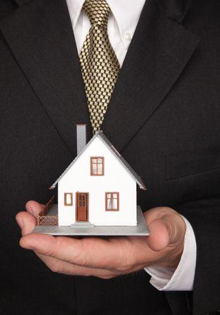 Man holding little house