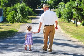People - grandfather and granddaughter walking